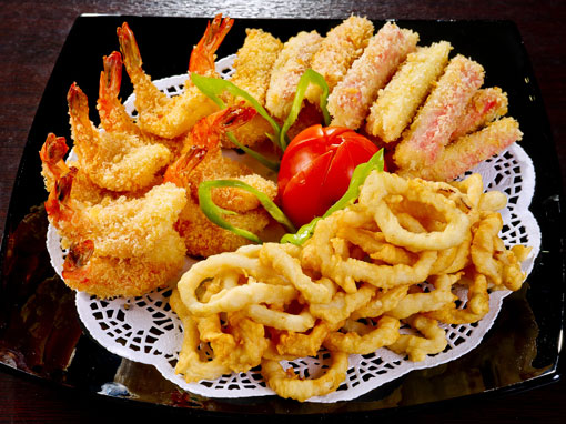 A plate full of different fried food