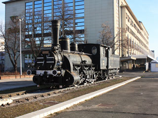 The model of an old black locomotive