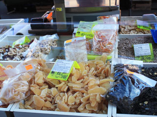 A stand with different kinds of dried fruit