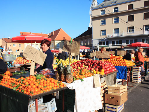 A stand with oranges on the market