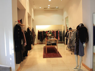 The inside of a shop with women's clothes