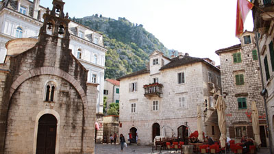 Old town square with stone houses and an old stone church