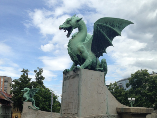 A statue of dragon on the corner of Dragon Bridge