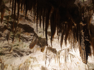 Stalactites hanging fron the ceiling of the cave