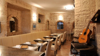 Tables and chairs in a room with stone walls