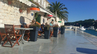 Restaurant's terrace on the boardwalk close to the sea