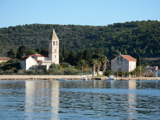 View of the island of Vis with a church and old stone house