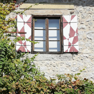 Stone wall with a decorated window