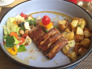 Roasted ribs served with potato and vegetables