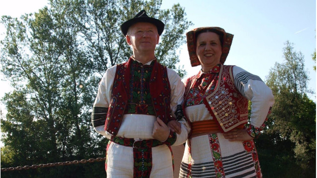 Two people in traditional clothing of the region