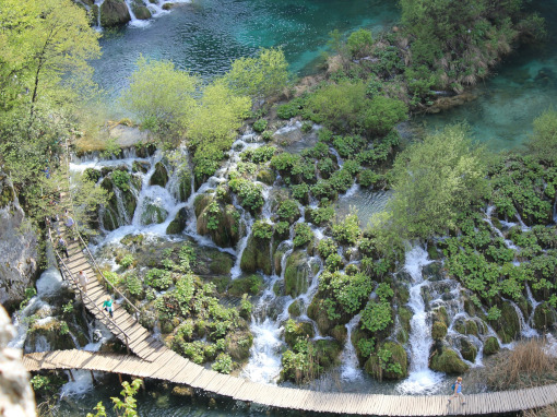 Aerial view of the lake, waterfall and the wooden passage in the national park