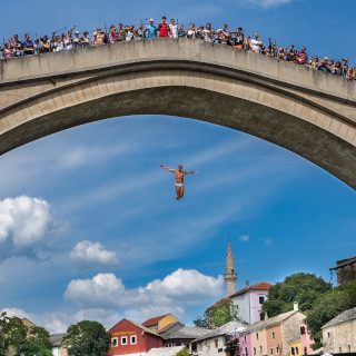A diver jumps from the bridge to the Neretva river