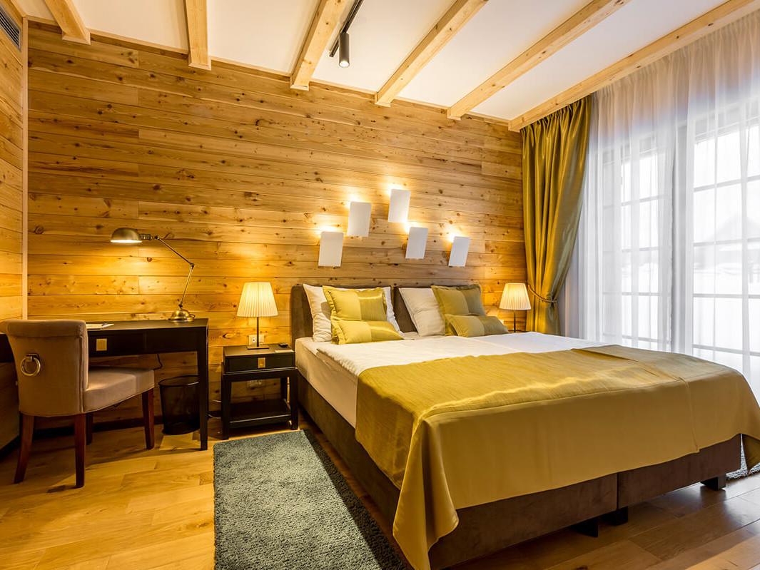 Luxurious bedroom with wooden panels on the wall