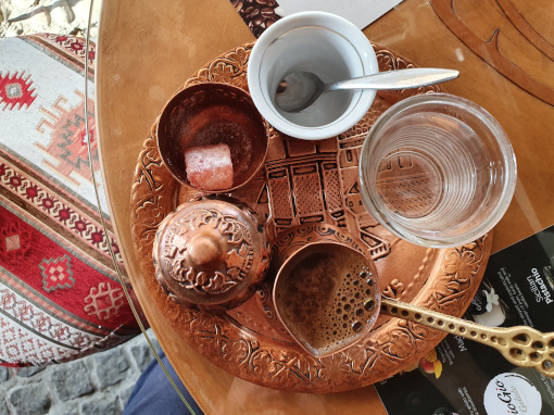 Copper tray with coffee set seen from the above