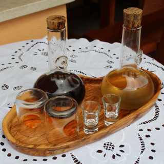 Two bottles and four glasses on a table