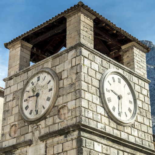 Close up of a stone-built clock tower