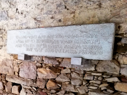 Stone table with glagolitic inscription hanging on the wall