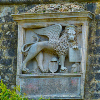 A relief of the lion holding a book