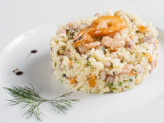 Plate with risotto and prawn