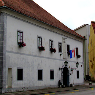 White building with flowers on the windows