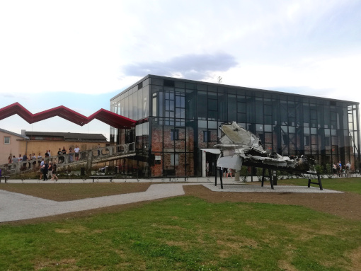 Glass building with an aircraft model in the front